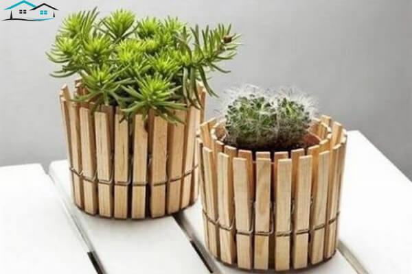 Chậu cây được làm từ kẹp giấy và vỏ đồ hộp